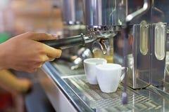 Barista making coffee Royalty Free Stock Photos