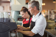 Barista making cup of coffee Royalty Free Stock Photo
