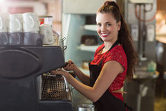Barista making a cup of coffee Stock Images