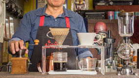 Barista making cup of coffee Royalty Free Stock Photos