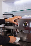 Barista making cup of hot coffee Stock Photo