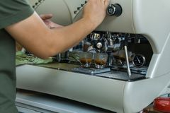 Barista making espresso coffee by espresso machine preparation service customer.  stock photo