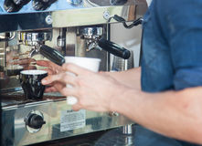 Barista making fine coffee Royalty Free Stock Photo