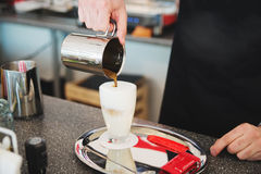 Barista making fresh coffee latte Royalty Free Stock Image