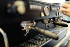 Barista making fresh coffee with machine. Professional barista making fresh coffee with machine Royalty Free Stock Image