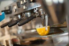 Barista making fresh coffee with machine. Professional barista making fresh coffee with machine Royalty Free Stock Photo