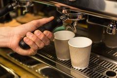 Barista making fresh takeaway coffee. Stock Photography