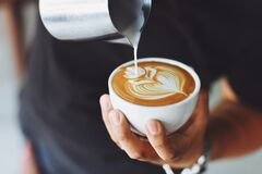 Barista making latte art Stock Images