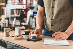 Barista making notes for preparing delicious beverage Royalty Free Stock Image