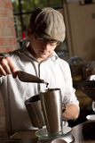 Barista measuring beans. A cafe employee measures the weight of the coffee beans for the next cup of coffee Royalty Free Stock Photos