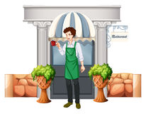 A barista outside the restaurant Royalty Free Stock Image