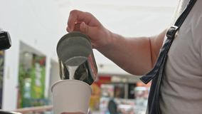 Barista poring hot milk in takeaway cup in slomo, detail. Barista poring hot milk in takeaway cup in slow motion, detail stock video