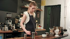 Barista pouring coffee and milk to a cup in the coffee shop stock video footage