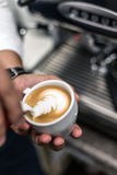 Barista pouring milk Royalty Free Stock Image