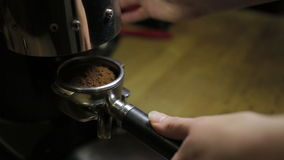 Barista pours ground coffee in holder coffee stock footage