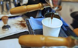 Barista making espresso shot at cafe stock images