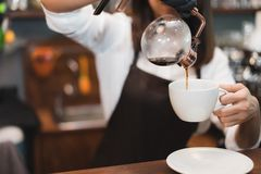 Barista prepare coffee syphon working order concept. stock images