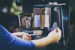 Barista prepares coffee in his shop stock illustration