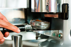 Barista prepares espresso Royalty Free Stock Photography