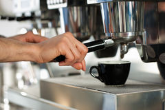 Barista prepares espresso Stock Photo