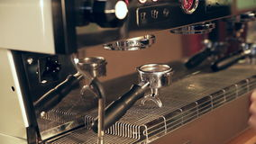 Barista prepares filter in holder for lungo coffee stock video footage