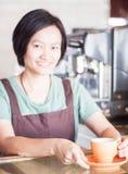 Barista prepares freshly brewed coffee Stock Photos