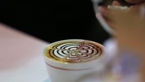 Barista prepares latte. Latte art.