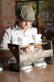 Barista prepares station for brewing. A cafe employee prepares a coffee brewing station for brewing Stock Photography