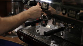 Barista prepares two cups of espresso. Medium shot stock footage