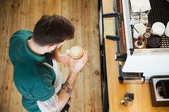 Barista preparing cappucino in cafe shop Stock Photography