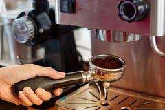 Barista preparing coffee in a cafe. Stock Photo