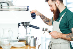 Barista preparing coffee. Male barista preparing coffee with coffee machine Royalty Free Stock Photos