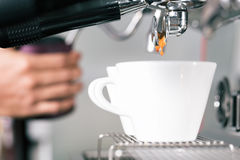 Barista preparing coffee with portafilter machine Stock Photography