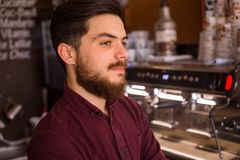Barista preparing cup of coffee royalty free stock photo