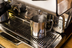 Barista preparing hot water for takeaway coffee Royalty Free Stock Photography