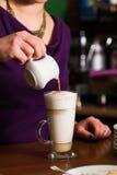Barista is preparing latte Royalty Free Stock Images