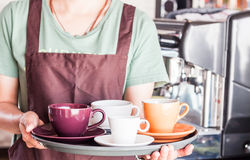Barista preparing set of freshly brewed coffee for serving Royalty Free Stock Image
