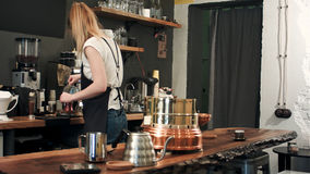 Barista preparing traditional boil Turkish coffee. Professional shot in 4K resolution. 089. You can use it e.g. in your commercial video, business stock image
