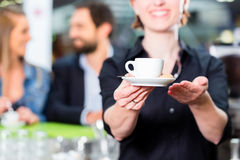 Barista presenting espresso in cafe Stock Photography