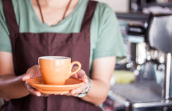 Barista presents freshly brewed coffee Royalty Free Stock Photo