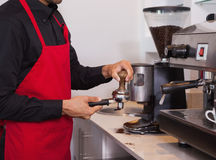 Barista pressing the coffee grounds Royalty Free Stock Photo