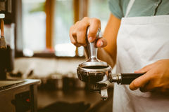 Free Barista Pressing Fresh Coffee Grinds Royalty Free Stock Photo - 44130175