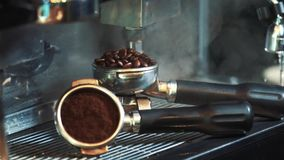 Barista roasting coffee beans grinder on coffee espresso machine stock footage