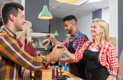 Barista serving clients give cup tea coffee shop bar counter Stock Image