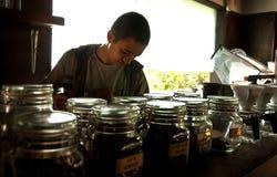 Barista serving coffee Stock Photo