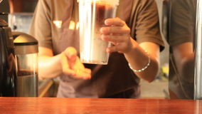 Barista Serving Doublewall Glass Of Iced Coffee Latte stock video