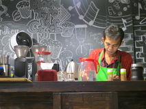 A barista serving drink. SERPONG, INDONESIA - June 4, 2017: A local coffee shop `Seduh Kopi` at Alam Sutera Royalty Free Stock Images