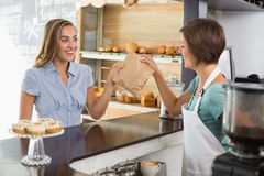 Barista serving a happy customer Stock Photo