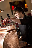 Barista Placing a cup Royalty Free Stock Photography