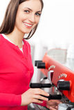 Female barista by coffee maker stock photography
